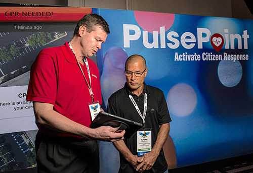 Discussing PulsePoint at a trade show booth.